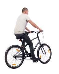 back view of a man with a bicycle.