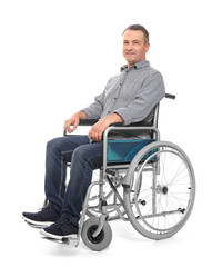 Mature man in wheelchair on white background