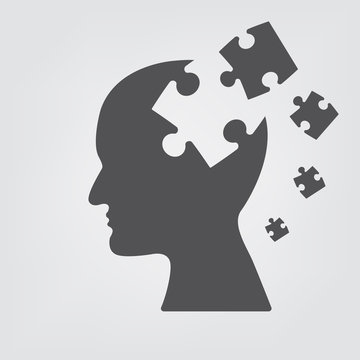People head with puzzles for psychology.  Business concept of mind exploding ideas .