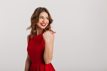 Portrait of a smiling young woman dressed in red dress