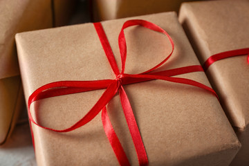 Parcel gift box on table, closeup