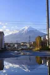 Aluminium Prints Reflection Fuji mountain in moning light with blue sky and Fuji reflect in water on road groundat Kawaguchiko, Yamanashi, Japan
