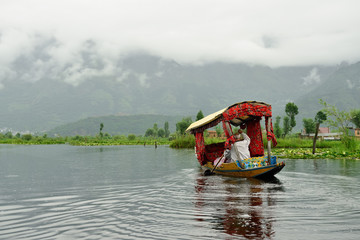 Local residents on the trip nice decorated Shikara, a small boat for transportation in the Dal lake of Srinagar