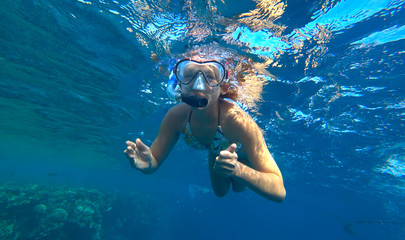 girl and snorkeling