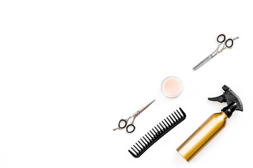 Professional tools for haircut. Sciccors, comb, spray on white background top view copy space