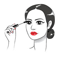 Beautiful young woman applying black eye mascara