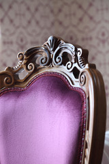 PURPLE WOOD OLD CHAIR SEATBACK WITH DECORATIONS DETAIL.