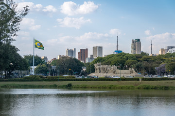Bandeiras Monument, Ibirapuera Park and city skyline with brazilian flag - Sao Paulo, Brazil
