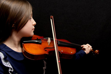 Little pretty girl playing violin