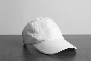 Cap on table against white background. Mockup for design
