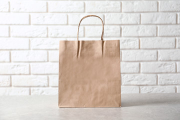 Paper bag on table. Mockup for design