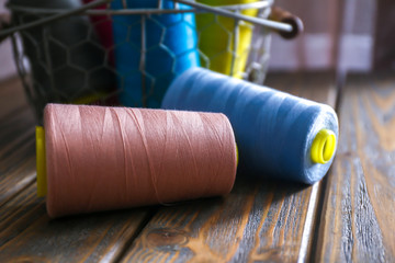 Color sewing threads on wooden table