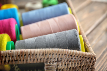 Wicker tray with set of color sewing threads, closeup
