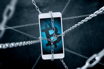Chained smartphone with bitcoin symbol. Conception of cryptocurrency security.