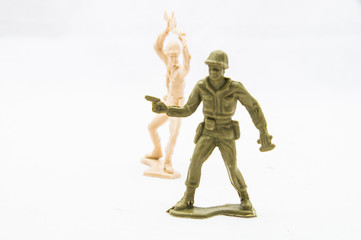 Toy soldier behind another toy soldier ready to attack