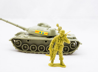 Toy soldier with radio and behind is a tank