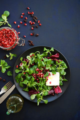 Fresh salad with pomegranate, raisins and feta cheese. Detox food concept