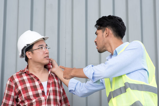 quarreling between angry engineer and construction worker
