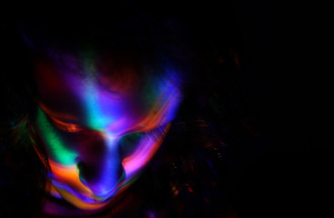 abstract portrait of young girl under colorful fluorescent Neon dark lights, enigmatic style.