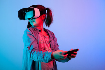 Young girl experiencing VR virtual reality headset game