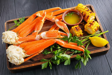 Crab legs, grilled corn in cobs