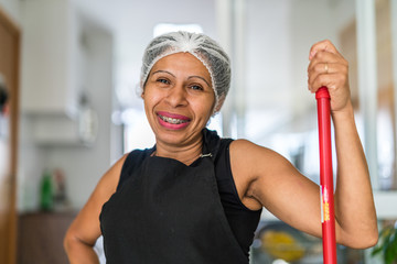 Latin woman house cleaner portrait at home