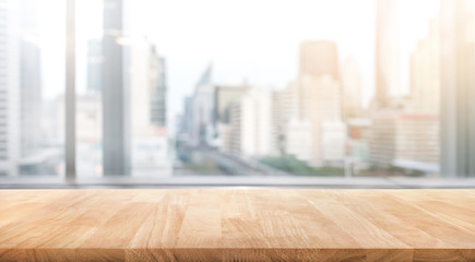 Empty wood table with blur room office and window city view background.For montage product display or design key visual