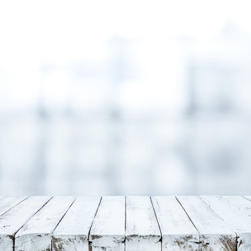 White wood table top on blurred white glass background