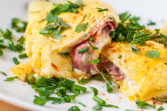 Egg omelette with ham and cheese with chive.