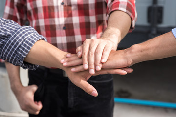 Work group of engineer people joining hands