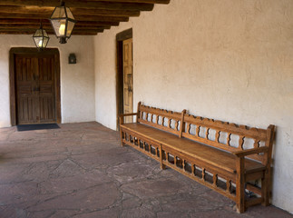 Southwest Style Portal with Carved Bench, Wooden Ceiling Beams and Overhead Lanterns