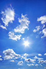 Deep blue sky with clouds at sunny day.