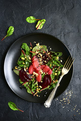 Delicious sald with chard leaves, beetroot and grapefruit slices.Top view.