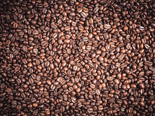 Background of  roasted coffee grains Food backdrop macro close-up
