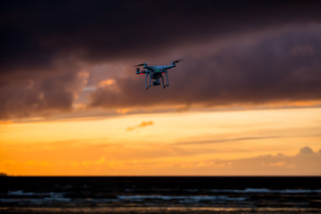 Flying drone over sea and cloud sky