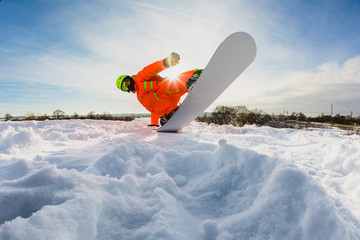 Snowboarder doing a trick on the ski slope