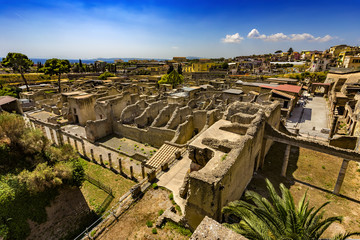 Italy. Ruins of Herculaneum (UNESCO World Heritage Site) - general view. There are the Palestra in the foreground and Decumanus Maximus in the right