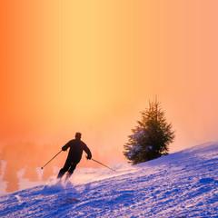 Skier in sunset light