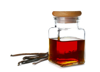 Jar with vanilla extract and sticks on white background