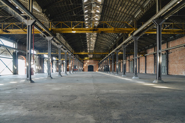 Old and dusty warehouse, with light coming through openings