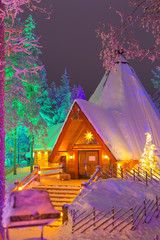 Travel Destinations Concepts. Unique Lapland Suomi Houses Over the Polar Circle in Finland at Christmas Time. Located in Front of Amazing Winter Forest Scenery in Finland