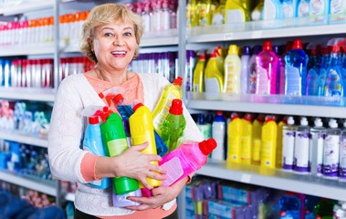 Woman consumer with household chemical products for washing indoors