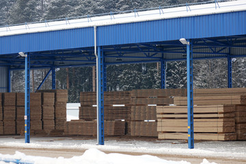 Lumber warehouse.New Stacked pallets .