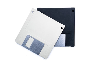 Old vintage computer floppy discs for disk for storing data. On grey and one black on an isolated white background.