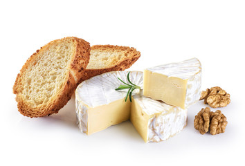 Camembert cheese, toasts, rosemary and walnuts isolated on white background.