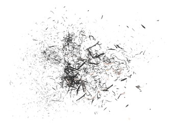 Graphite stained eraser shavings isolated on white background, top view