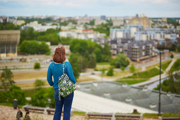 Tourist looking at panorama of Vilnius Old Town, Lithuania