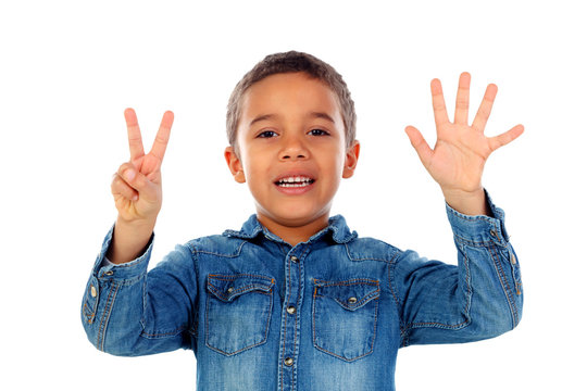 Adorable child counting with his fingers