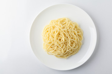 A plate of spaghetti pasta isolated on white background. Wall mural