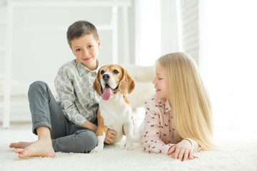Children with a dog